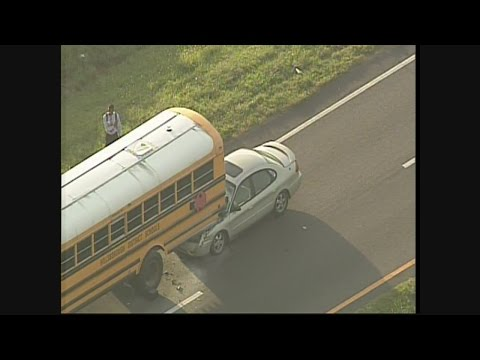 Car runs into school bus in Gibsonton