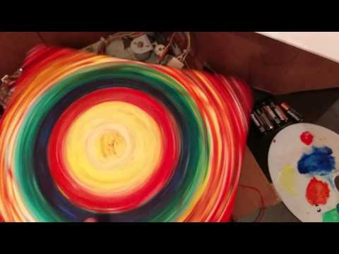 Old record player hacked into canvas spinner
