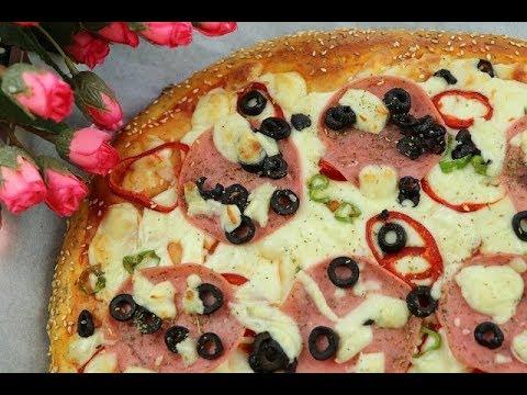 صورة  طريقة عمل البيتزا أطيب واسهل طريقة لعمل بيتزا بعجينة طرية قطنية مميزة تستحق التجربة مع رباح محمد ( الحلقة 457 ) طريقة عمل البيتزا من يوتيوب