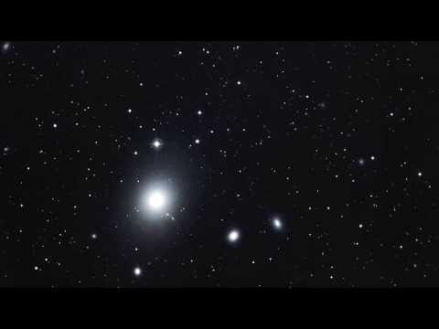 We zoom into the giant elliptical galaxy M 87 Zoom Into Black Hole Jet