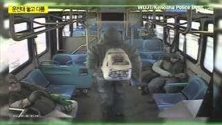달리는 버스 운전대 놓은채 승객과 몸싸움