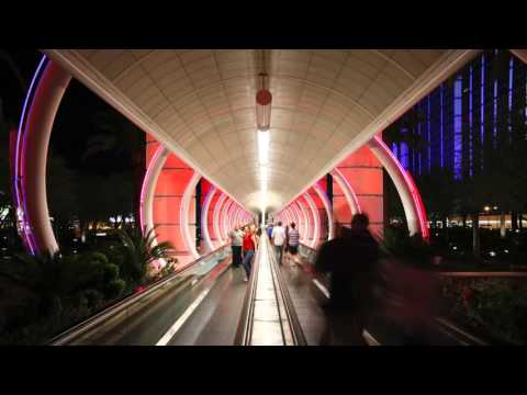 illuminated walkway travelator time lapse of the entrance to a casino