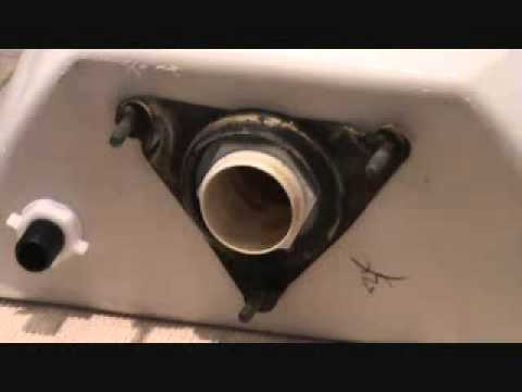 replacing toilet tank parts.  The toilet from hell removing a leaking tank gasket YouTube