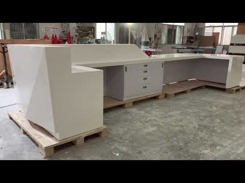 White acrylic solid surface reception desk