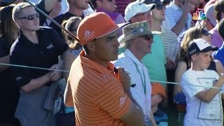 Rickie Fowler gets lucky off the tee on No. 18 at Waste Management