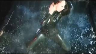 Girl in latex catsuit dancing in the rain