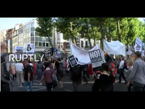 LIVE: Thousands march in Brussels against Trump's visit