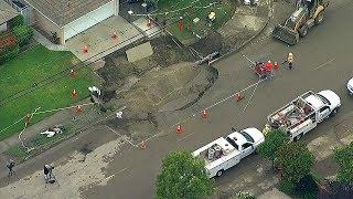 VIDEO: Sinkhole swallows SUV, chunk of street in California neighborhood | ABC7