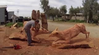 Jordan Anderson Carving Fighting Whitetail Bucks
