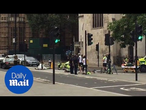 Paramedics treat cyclists after Westminster terror attack