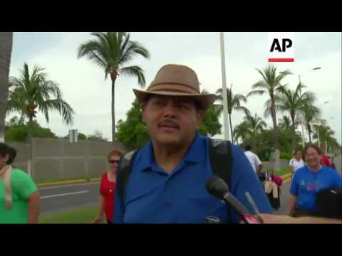 Relatives and classmates of 43 missing students blocked access to Acapulco airport in the southern M