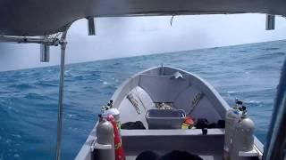 25 foot Imemsa Panga cruising at 20 MPH in 6 foot Offshore seas- 65HP tiller controlled engine