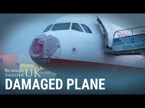 Hailstones damaged the nose of this plane