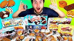 TRYING EVERY LITTLE DEBBIE DESSERT!!! - Zebra Cakes, Cosmic Brownies, Donuts & Cupcakes Taste Test!