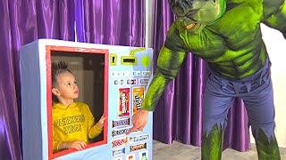 Damian and superheroes vending machine kids toy story