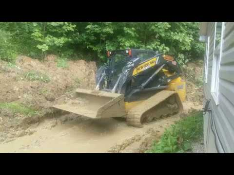 Caving a Root Cellar Into the Hillside With a Track Hoe