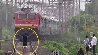 stupid guy giving titanic pose forcing terrified driver to slow down the speeding express train