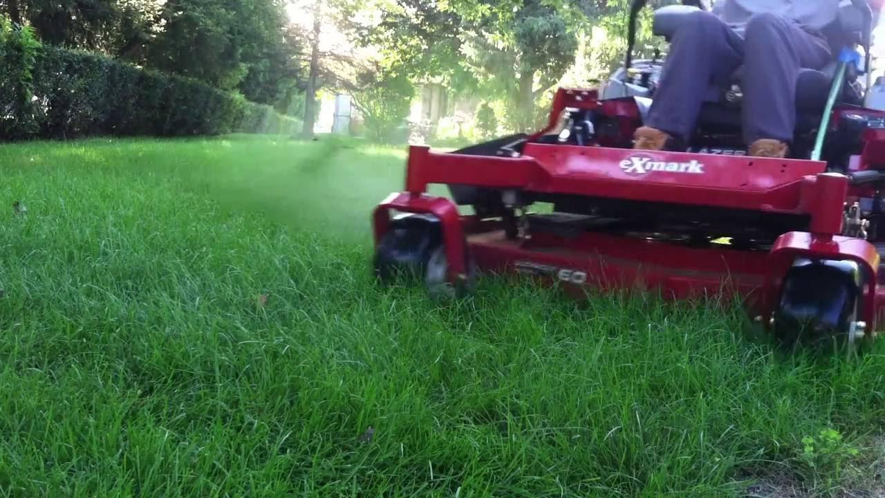 lawn mowing with Exmark Lazer z 60''