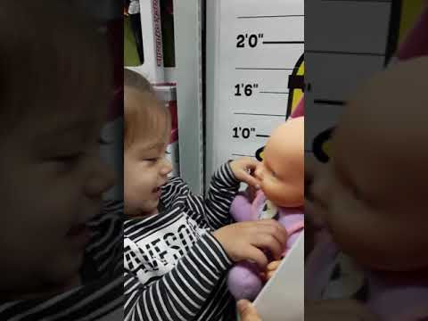 Baby Kyla laughing with the doll