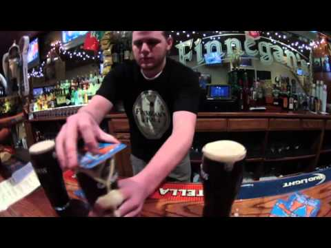 Bartender flips 3 full glasses of Guinness