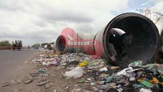 Pan shot of an illegal roadside garbage dump in India - environmental pollution