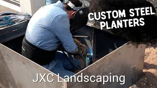 Custom steel planters by JXC Landscaping