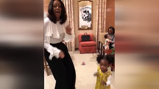 2-Year-Old Pictured in Awe of Michelle Obama Portrait Gets to Dance With Her thumbnail