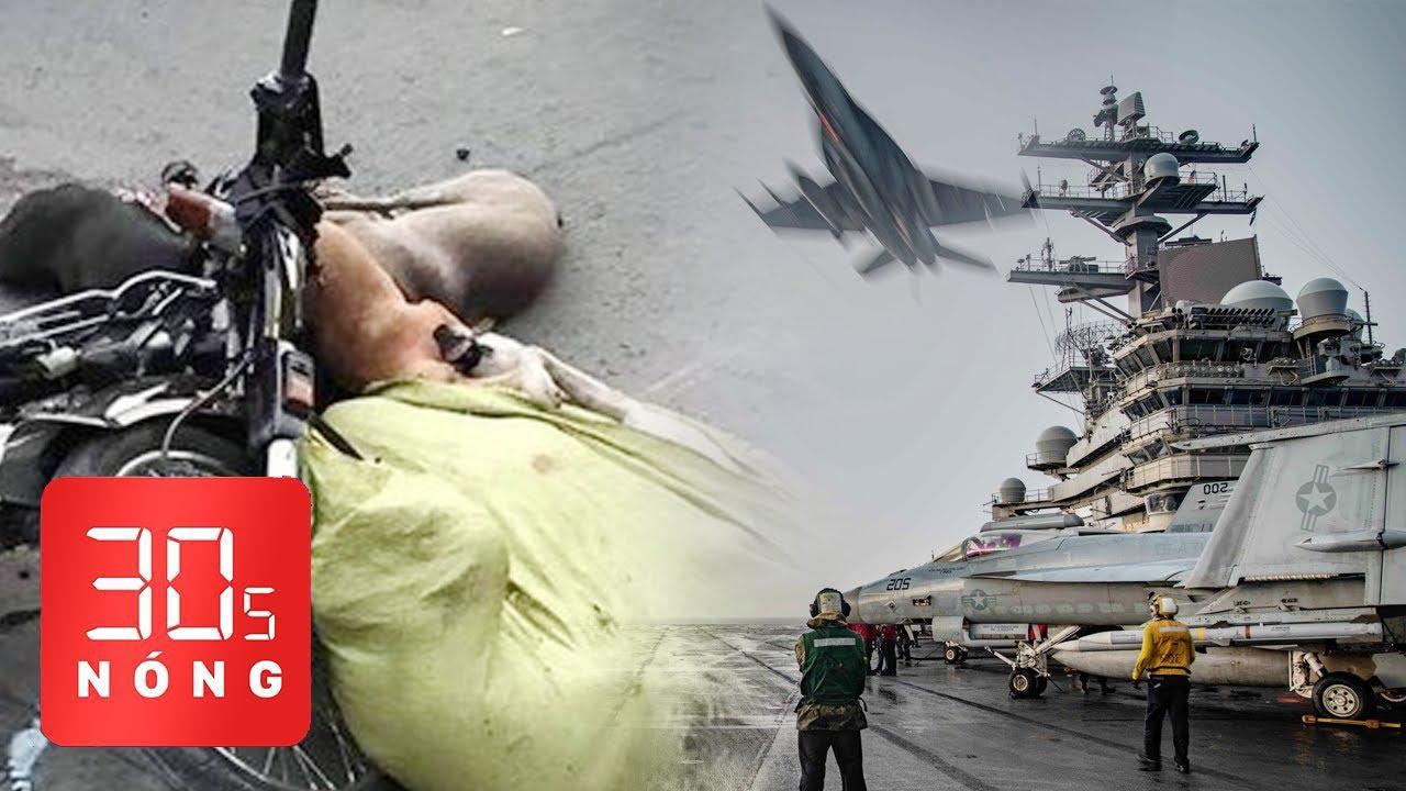 """Bản tin 30s Nóng: Xe máy đụng nhau, """"lòi ra"""" bao xác chó; Hải quân Mỹ tập trận trên Biển Đông"""