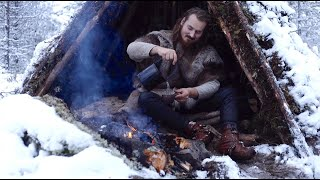 Viking bushcraft trip - snow, tipi, pine tea, wilderness, reindeer skins, cooking meat etc.