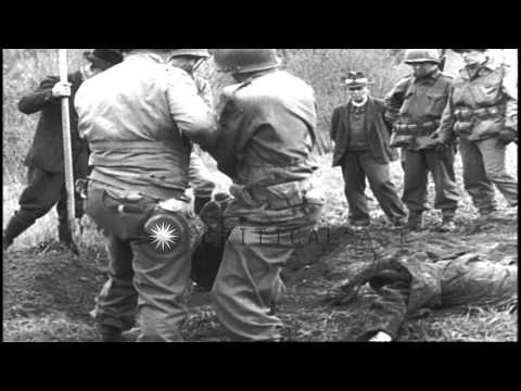 Bayonets and bullet wounds on the heads and chests of dead bodies in Flossenburg,...HD Stock Footage