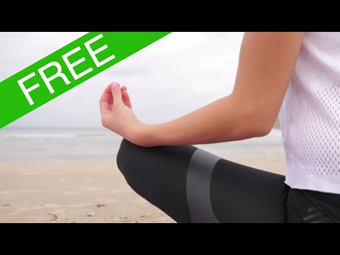 Yoga on the beach in super slow motion. Free stock footage clip.