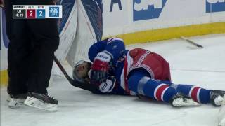 Zibanejad injured sliding hard into end boards feet first