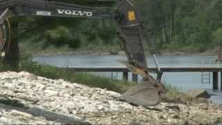 Learn to operate excavator - Rip Rap and geotextile - Placing Rip Rap on Geotextile Fabric.avi