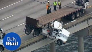 Front of semi-truck dangles off I-75 bridge over Manatee River - Daily Mail