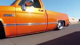 bagged orange c10 cruising on raceline billets