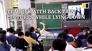 Teacher with back pain lectures while lying down on chair
