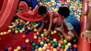 Kids playing with balls / ball playing / lots of balls to play