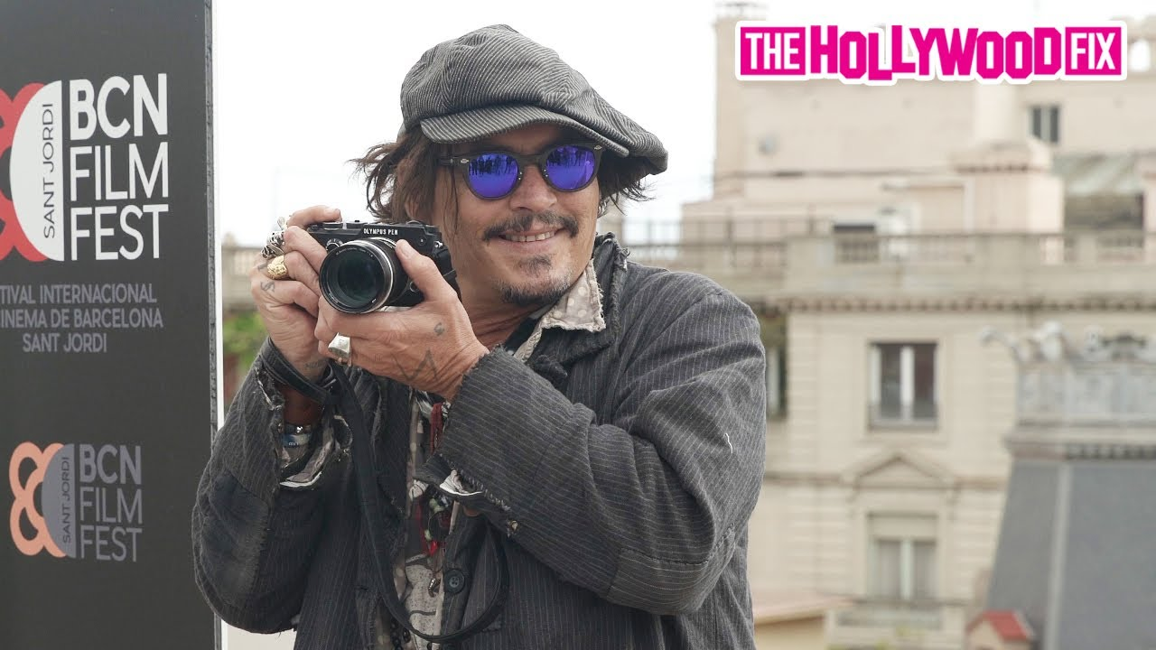 Johnny Depp Pretends To Be Paparazzi Before Signing Autographs & Greeting Fans In Barcelona, Spain