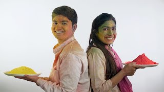 Indian teenagers covered in colorful Gulal smiling at the camera - Holi festival