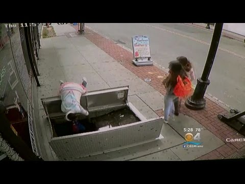Woman Distracted By Phone Falls Into Sidewalk Hole