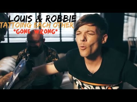 LOUIS TOMLINSON AND ROBBIE WILLIAMS TATTOOING EACH OTHER *gone wrong*