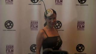 Jossara Jimaro...dazzling hat style on red carpet!  Asian Pacific Film Festival...