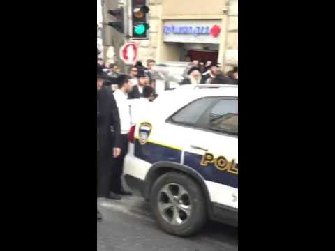Police making an arrest at Kikar Shabbos (Media Resource Gro