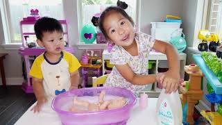 Camilla & Ryan play pretend with baby doll, adopt a cat