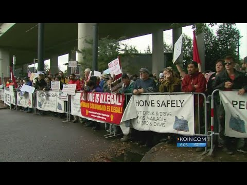 Attorney General Jeff Sessions met by protesters in Portland