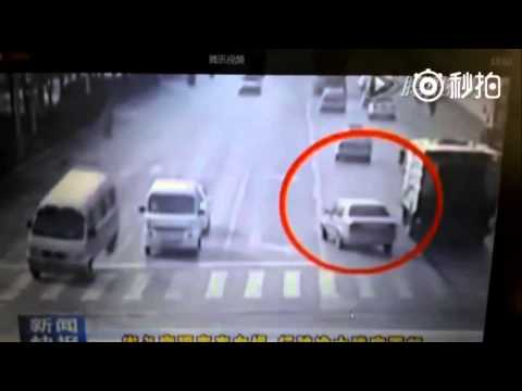 Levitating cars in China or cable caught in street sweeper?