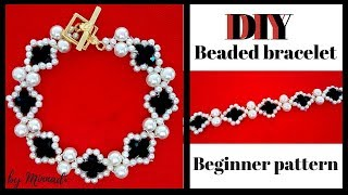 Make a beaded bracelet with white and black beads. Jewelry making tutorial