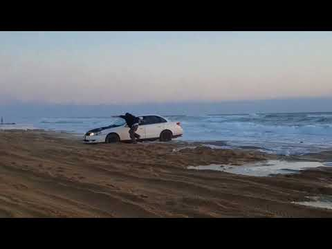 Ocean rolls in with 2 kids in the car. Pismo beach