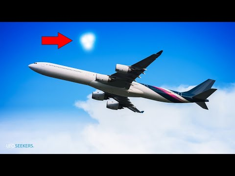 Shape-Shifting UFO Appears Near Airplane... Or is it Balloons?