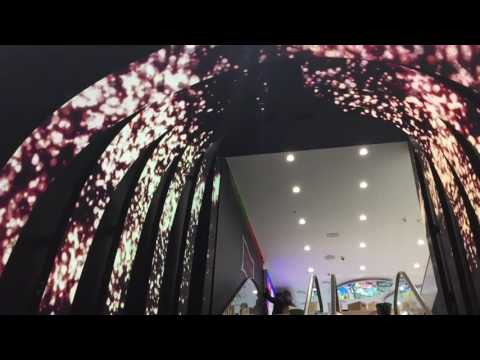 Flexible LED screen display building on escalator in Rive Gauche's store St Petersburg, Russia